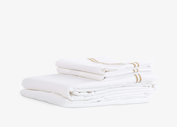 envello Select Sateen white cotton sheet set with contrasting brown trim featuring  1 flat and 1 fitted sheet plus 2 pillowcases