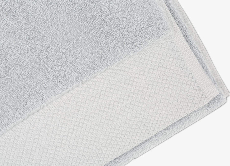Detailed view of envello light blue cotton Washcloths