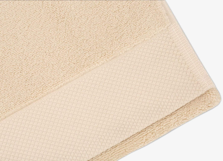 Detailed view of envello bone coloured cotton Washcloths