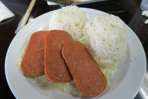 The popular Spamsilog dish consists of Spam, Sinangag (fried rice) and  Pritong itlog (Fried egg).   https://www.flickr.com/photos/mmm-yoso/25885399847