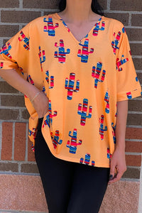GJQ7758 Orange top w serape printed cactus