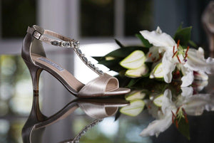 bridal shoe and wedding flowers