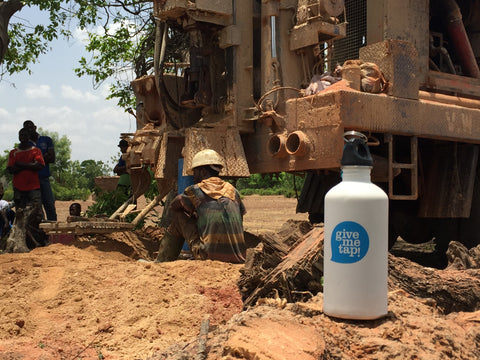 GiveMeTap water bottle at water pump in Africa, Ghana