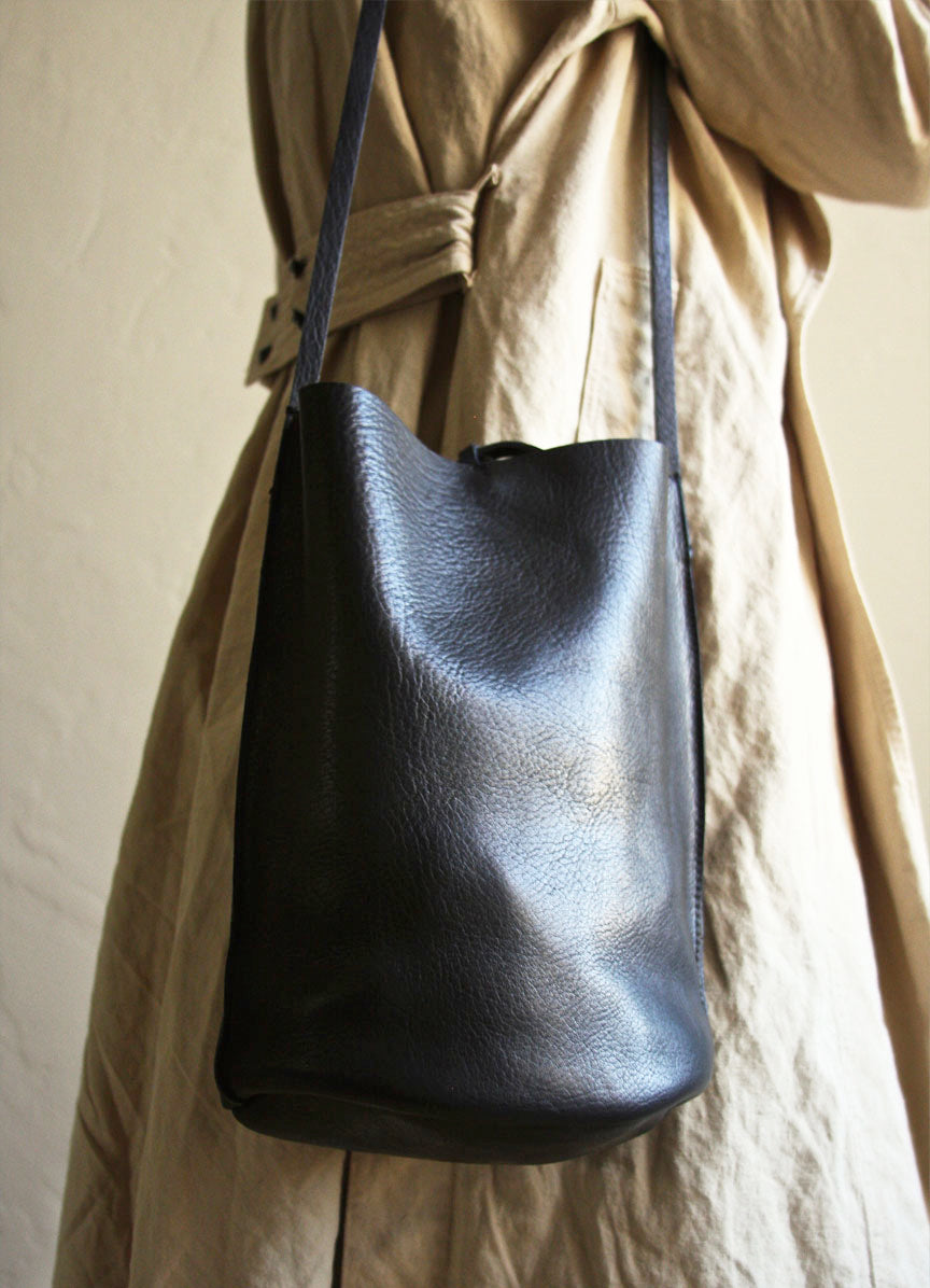 Black Leather Crossbody Bucket Bag. Minimalist design.