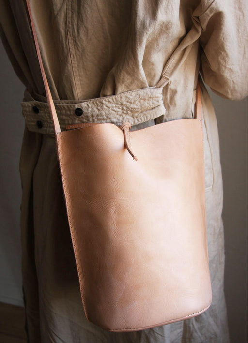Nuraxi Leather Crossbody Bucket Bag handcrafted in Argentina.