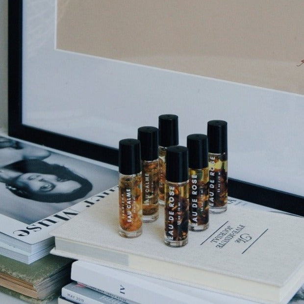Cream, black and beige bottles of natural perfume oils