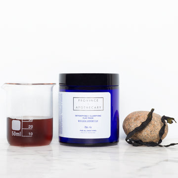 Organic clay mask in deep blue jar with glacial and bentonite clay