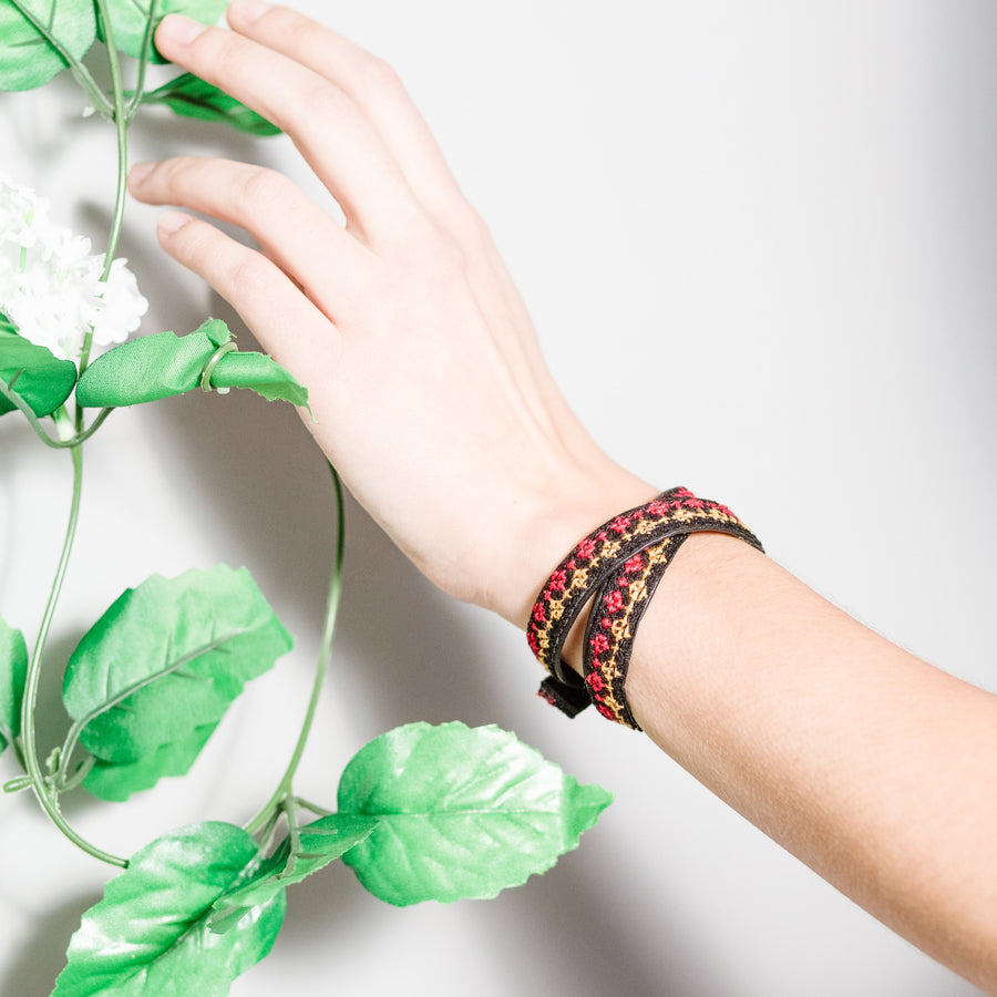 Ethical tatreez leather wrap with red pattern as two layered bracelet