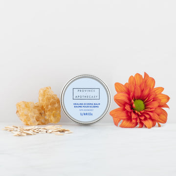 Healing eczema balm with calendula and zinc against white background
