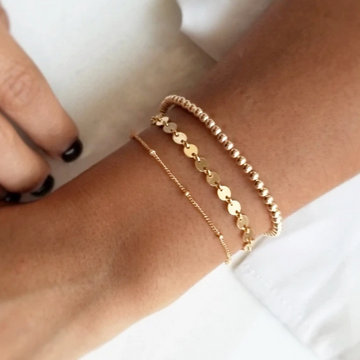 Gold beaded bracelet on model