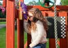 Best Backyard Swing Sets - a child enjoys periscope on Swing Set Paradise