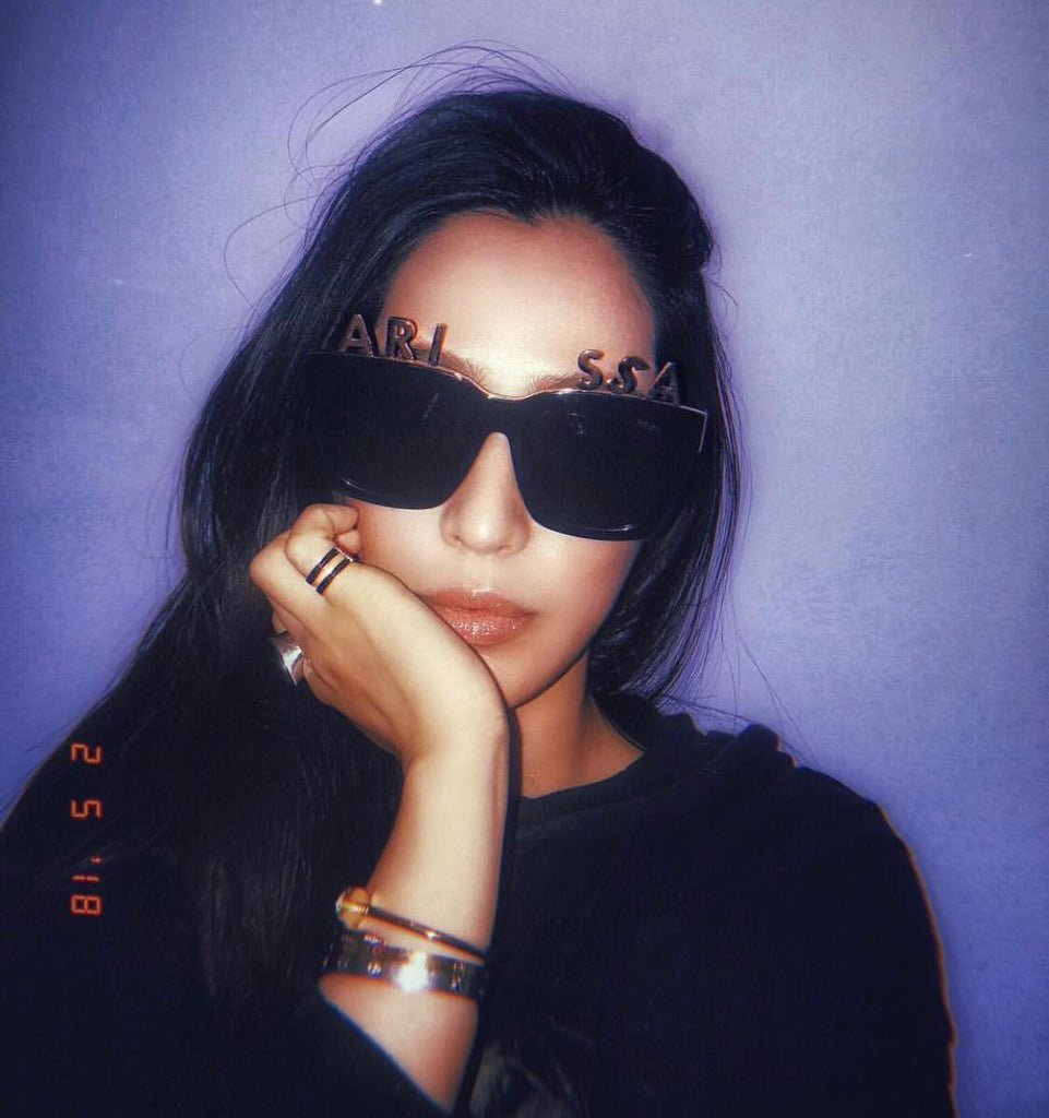 Socialite Arissa Cheo wears REVÉ by RENÉ Alphabet Bar Sunglasses and Gold Plated Letters.