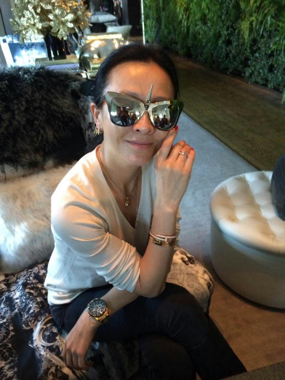 Actress Carina Lau 劉嘉玲 wears REVE by RENE unicorn I am the limited edition sunglasses