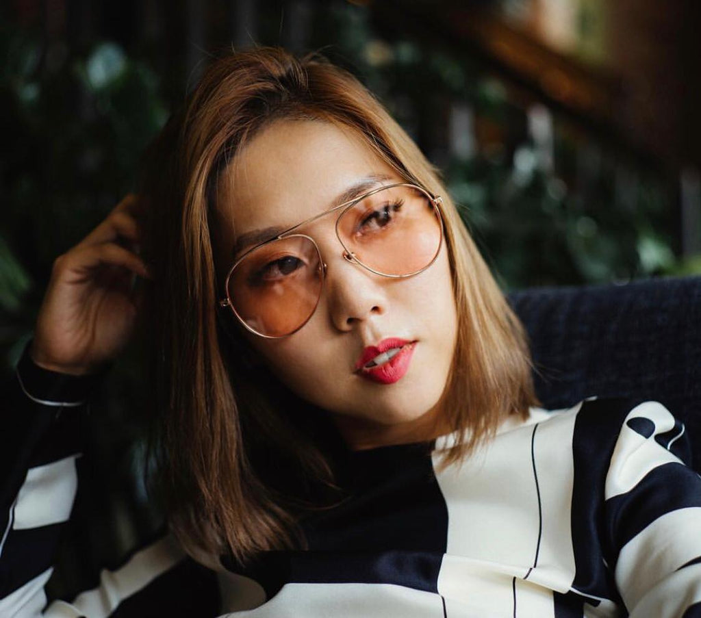 Faye Tsui wears REVÉ by RENÉ Jelly Bean Pink glasses.