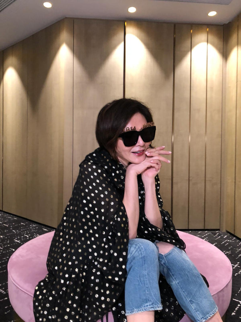 Actress Rosamund Kwan wears Alphabet Bar Sunglasses and Gold Plated Letters.