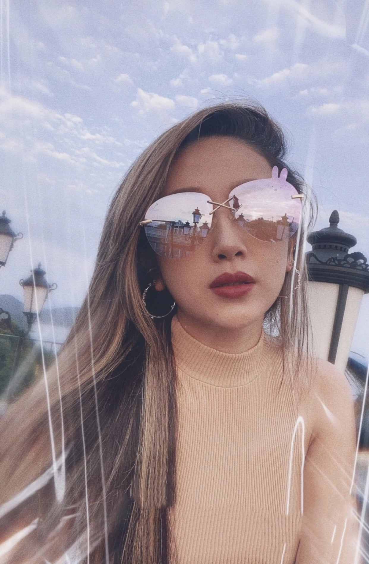 Sarah Zhuang wears REVE by RENE Miffy fairy dust sunglasses