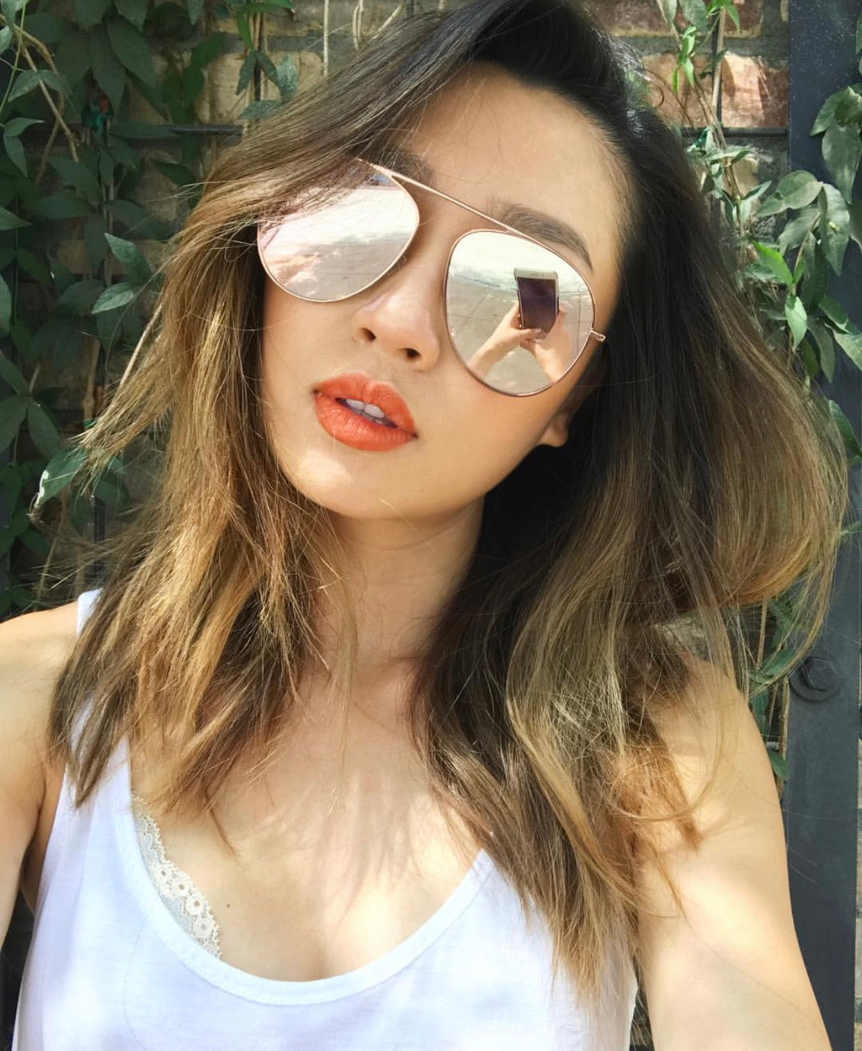 Hair and Makeup Artist and Owner of Pallete Studios Yuri Sinata wears REVE by RENE glimpse aviator sunglasses