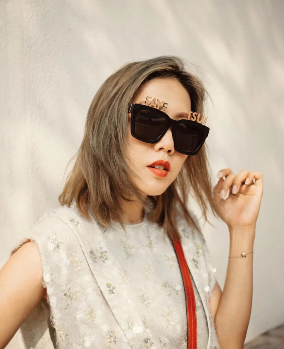 Fashion blogger Faye Tsui wears REVE by RENE alphabet sunglasses
