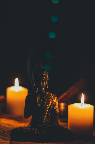 budda with candle spirtual photo