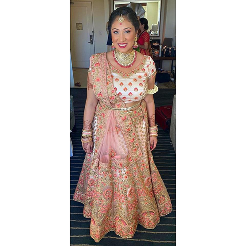 PEACH BRIDAL TRADITIONAL LEHENGA WITH ZARDOZI AND THREADWORK. PAIRED WITH A BELT.