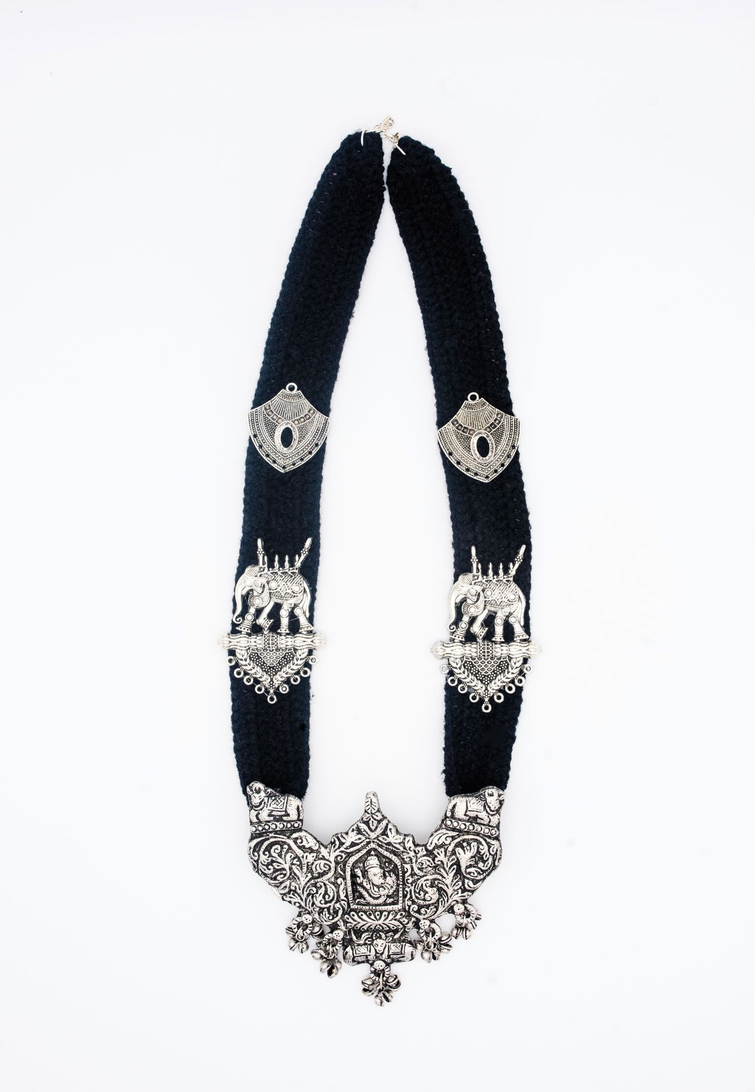 ETHNIC CARVED SILVER FINISH PENDANT ON BLACK THREAD NECKLACE