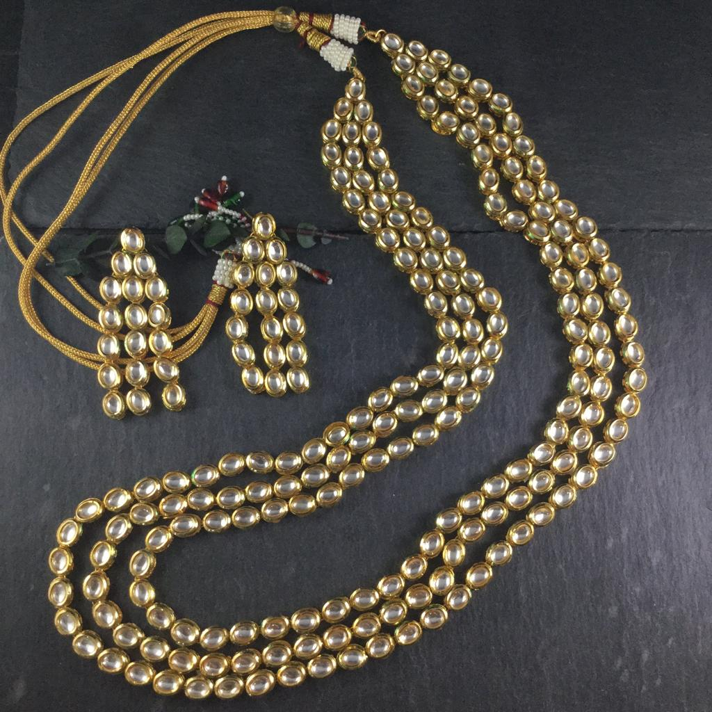 STUNNING 2 LAYER KUNDAN SET WITH MATCHING EARRINGS BY REEMAT DESIGNS.  FEATURES ADJUSTABLE LENGTH.