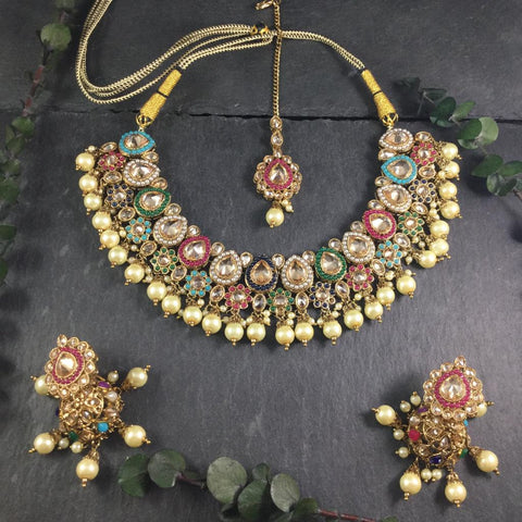AN INTRICATE SHORTER REEMAT CHANTELLE SET WITH AN ARRAY OF COLORS.  COMES WITH JHUMKI EARRINGS AND TIKKA.