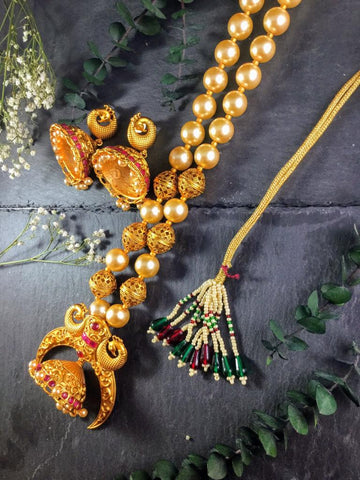 A GORGEOUS TEMPLE SET WITH PEARLS AND MATCHING EARRINGS BY REEMAT DESIGNS.  FEATURES ADJUSTABLE LENGTH.