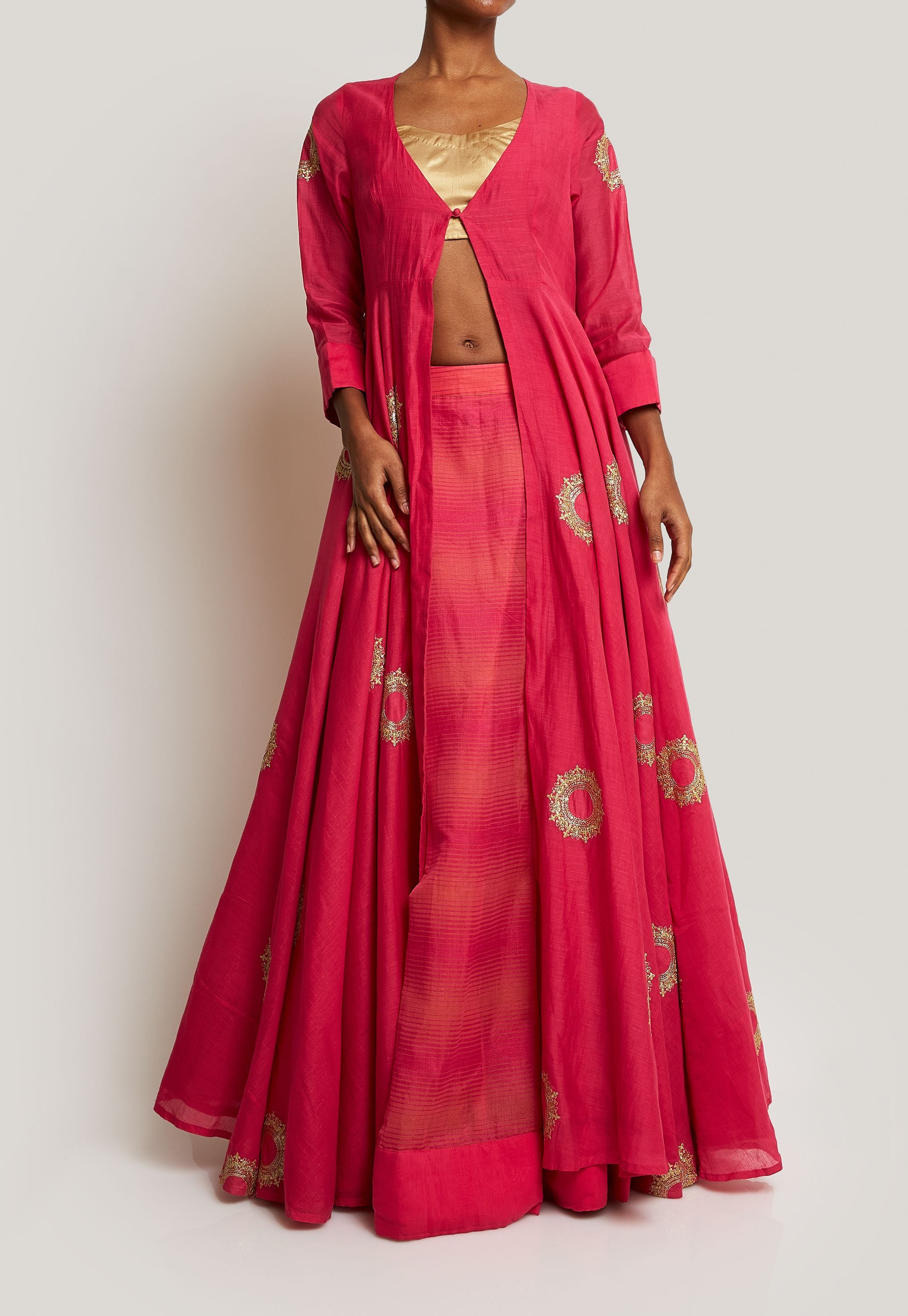 LONG A-LINE JACKET WITH FRONT CLOSURE, GOLD BLOUSE AND A FLOWY LEHENGA