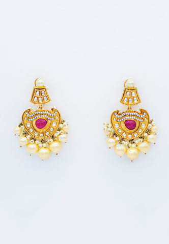 GOLD EARRINGS FEATURING PEARL DROPS ACCENTED WITH PINK STONE