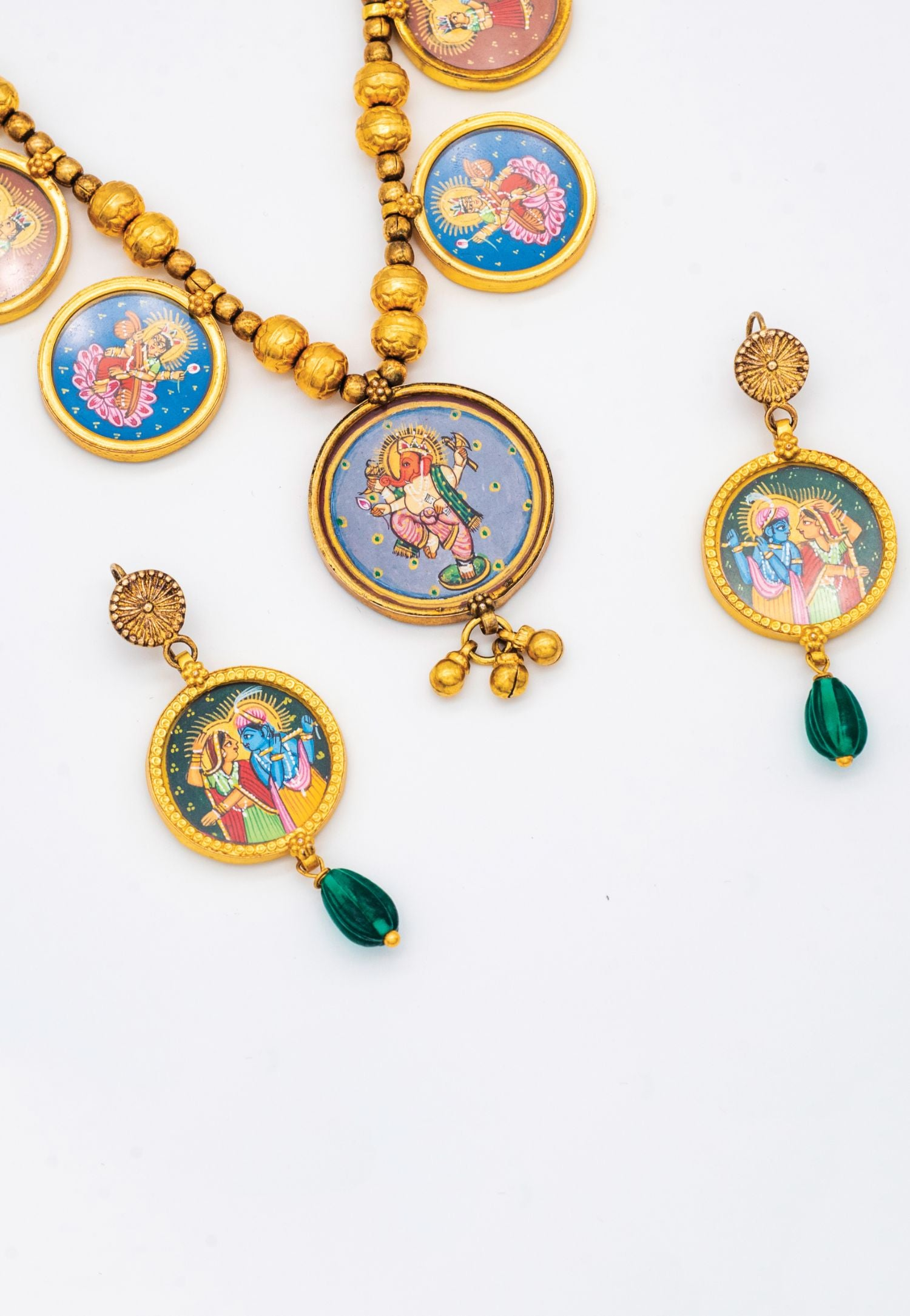 AMRAPALI GOLD SET FEATURING RADHA AND KRISHNA