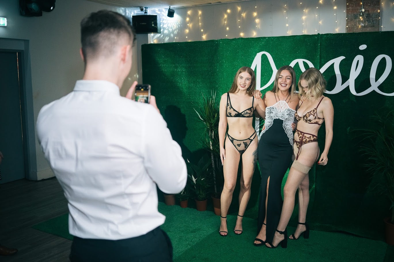 Guests taking a picture with models