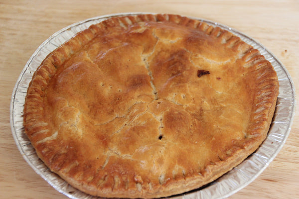 A large steak pie, crafted from local ingredients at our deli