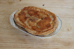 A small chicken pie, fresh from the butcher