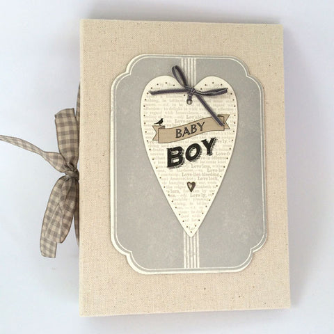 Celebrate and cherish those special baby moments. Gorgeous Baby Boy Heart Photo Album