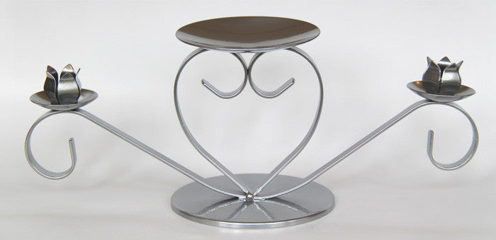 Charming heart shaped taper candle holder. Stylish, affordable candleholders made in UK.
