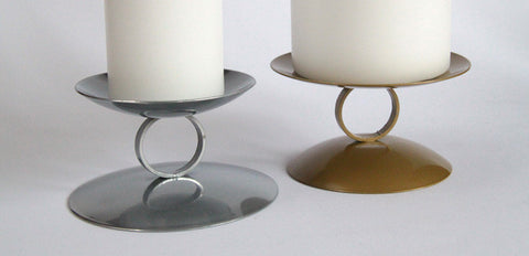 Reversible Pillar Candle Holder. Available in silver and gold. Made in UK.