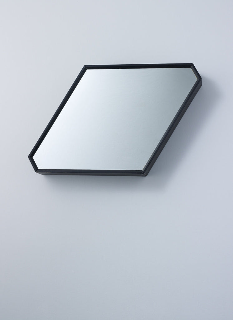Rhombus shaped mirror