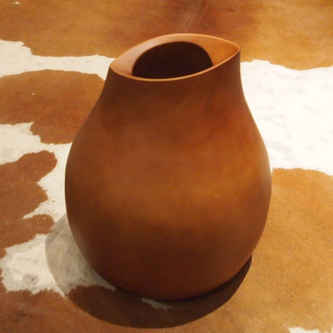 Tall sculpted wood vase
