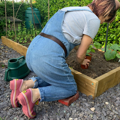 woman gardening in Poddy and Black garden shoes