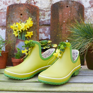 bright green gardening shoe with flowers