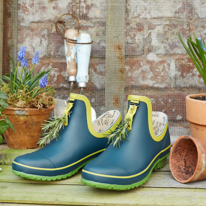 dark blue and green gardening shoe with real plants