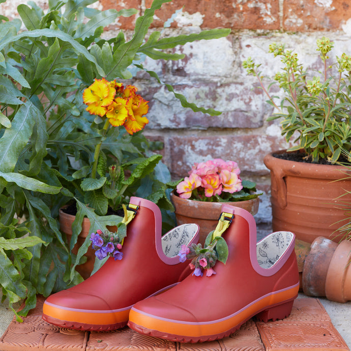 Red gardening shoe with flowers