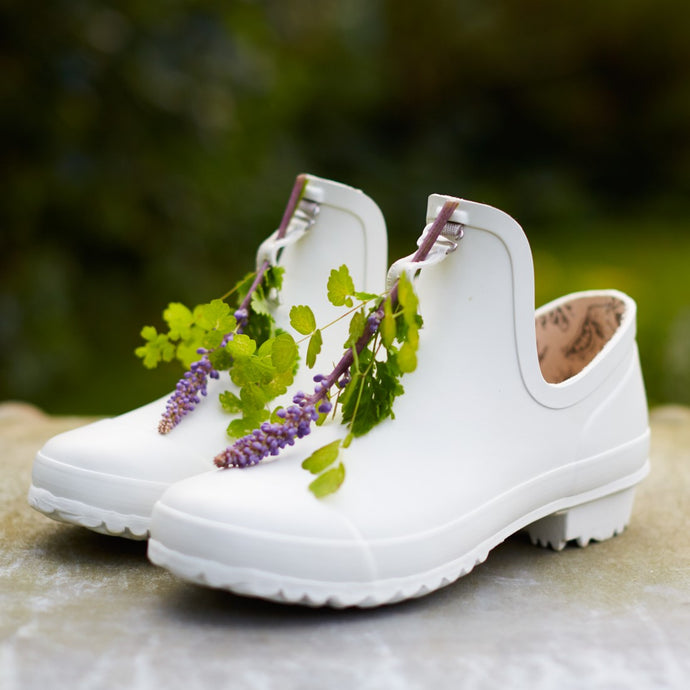 white gardening shoe with flowers