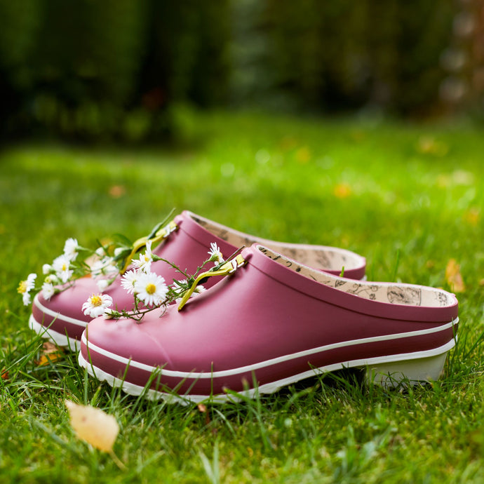 garden clog in pink with flowers on lawn