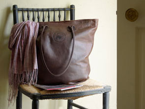 Handmade leather shopping bag sitting on chair