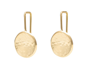 Round drop earrings in yellow gold with hammered texture in bowl on shepherd's hooks.