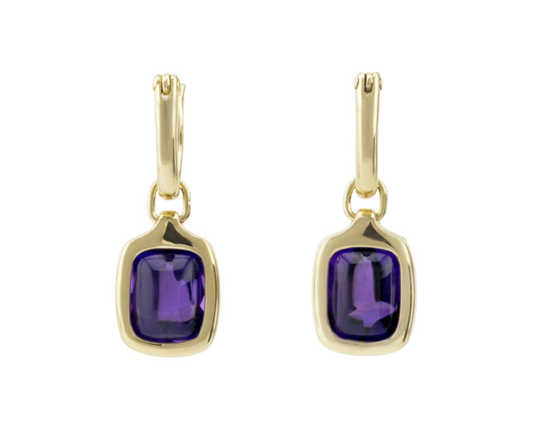 Rectangle drops with bright purple cabochon gem in green gold frame. Drops hang on small U shaped hoops in solid green gold.