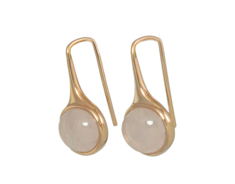 Oval drop earrings in rose gold on shepherd's hooks set with oval pink quartz cabochon gems.