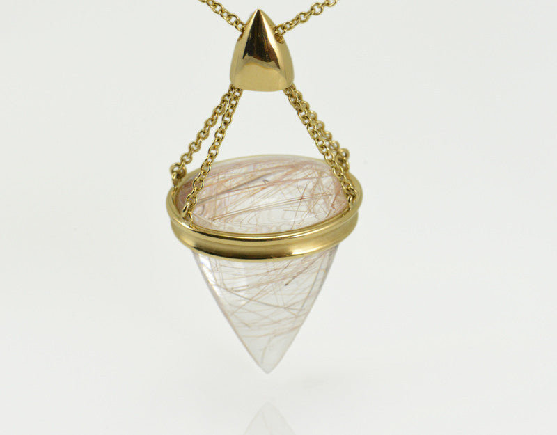 Very large pear shaped gem clear white with golden threads, intricate gold cap and chain.